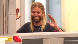 Foo Fighters Drummer Taylor Hawkins Handles Enhanced Pat-Down By LAX TSA Like A Champ