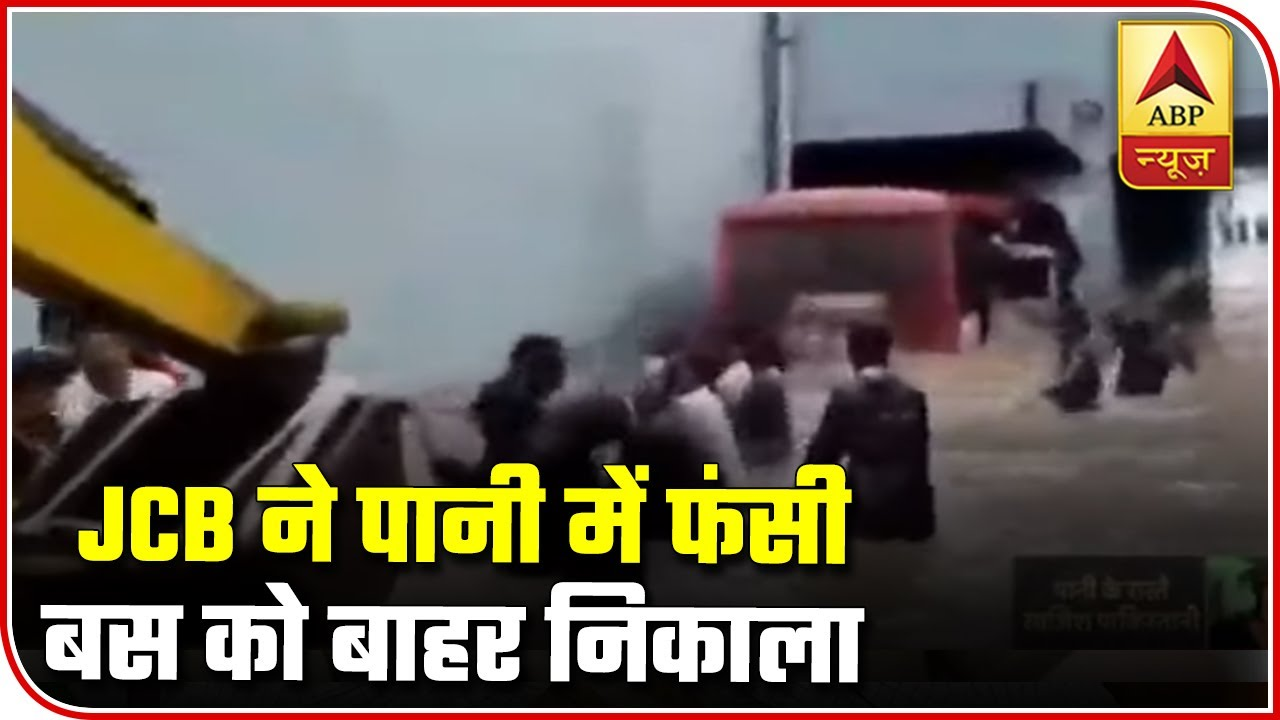 Rajkot: JCB Extracts Bus Stuck In Water Logged Street | ABP News