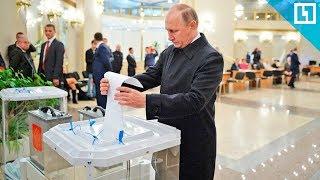 Владимир Путин голосует на выборах президента