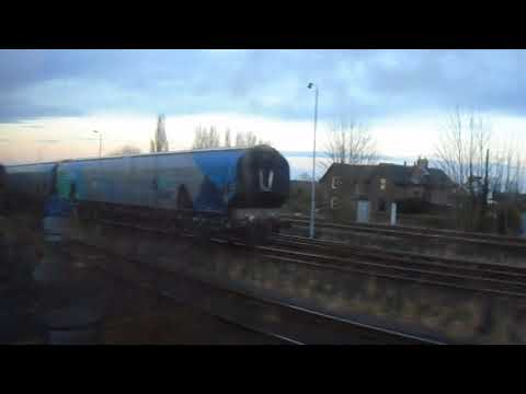 60009 Union of South Africa pulling the YYE 07 passing more freight