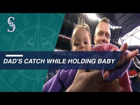 Dad makes an AMAZING grab while holding his baby