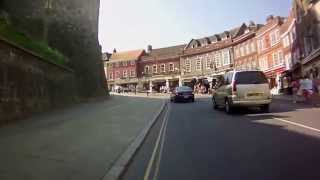 Cycling into Windsor High Street past Windsor Castle on a Specialized Roubaix Comp