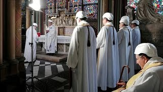 Priests in hard hats host first Notre-Dame mass since devastating fire