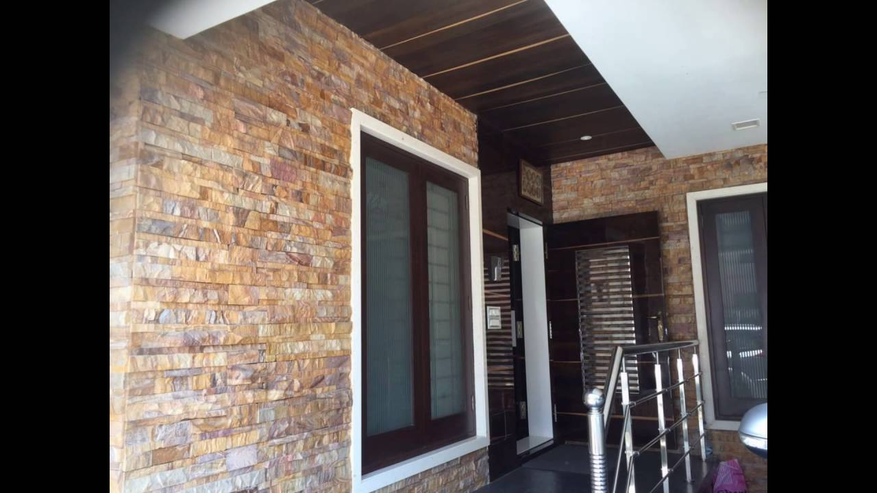 Stone showroom bangalore interior exterior cladding for Minimalist stone house