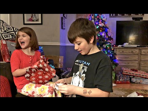 Kid's Christmas Morning Presents Opening With A Disneyland Trip Surprise!
