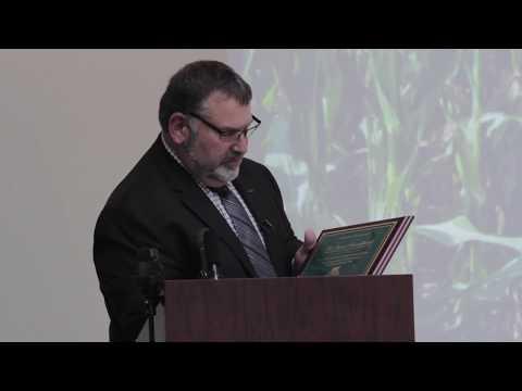 MFB President Carl Bednarski Honors Dr. Dave Schweikhardt