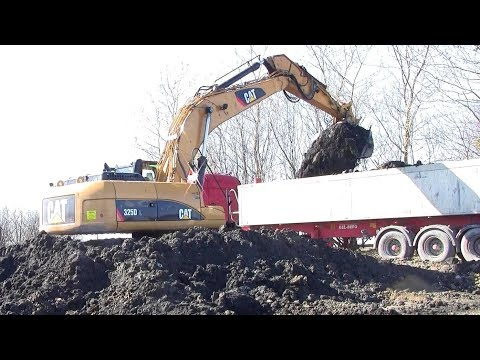 Loading Scania Truck With The Cat 325D Excavator On The Harbor