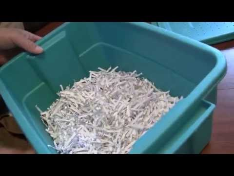 Creating an earth worm farm with a plastic tub and shredded paper/soil