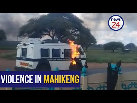 Mahikeng unrest - Cop car pelted with petrol bomb