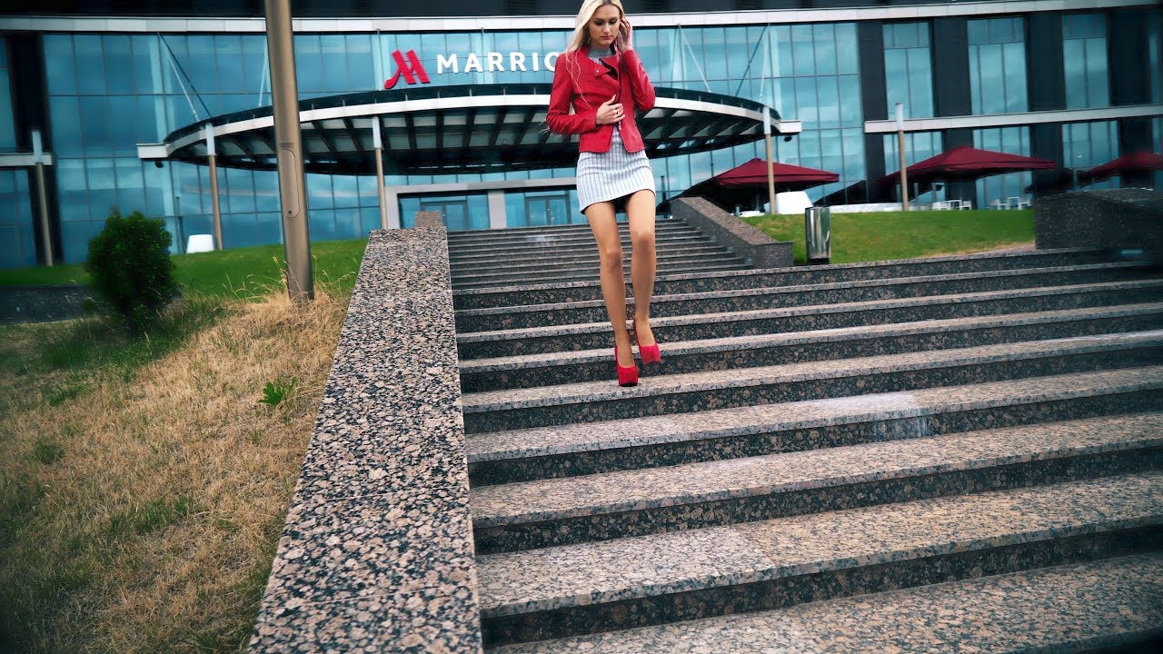 Confident Walking Near River and Fountains in High Sexy Heels. High Heel pumps walking
