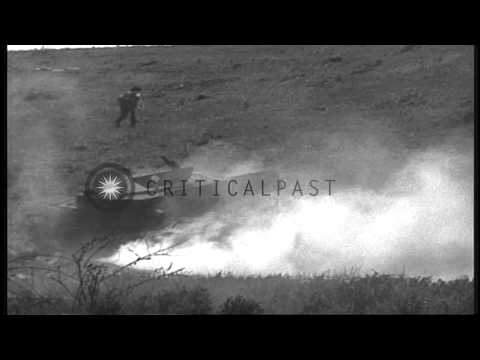 Grenades explode near a wrecked Italian tank during a US 3rd Division training ne...HD Stock Footage