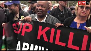 Hundreds of people stood in the rain on the lawns of the Union Buildings in Pretoria calling for action against farm attacks.