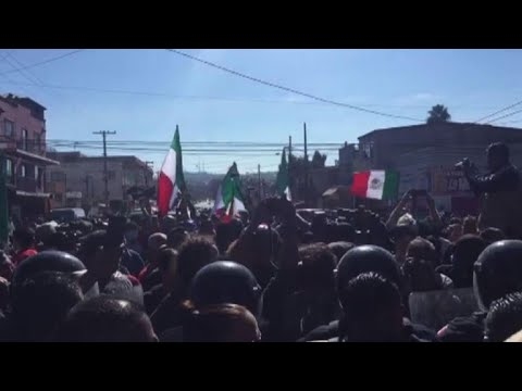 Anti-immigrant protesters in Mexico try to reach migrant shelter