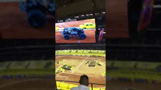 Monster jam racing in at&t stadium at Arlington Texas