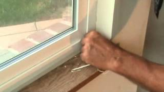 How to remove caulking around a window frame