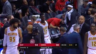 Woman throws up directly behind an NBA team bench in Miami Heat at Atlanta Hawks game - Dec 19, 2017