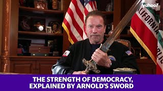Arnold Schwarzenegger uses a sword to describe the strength of democracy