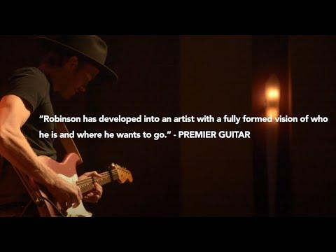 joe robinson bass guitar - 986×574