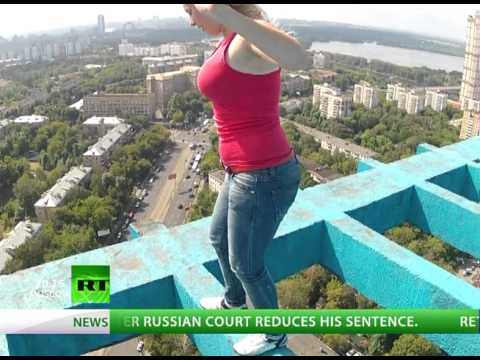What a view! Daredevil climbs atop Moscow skyscraper