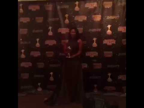 Her Majesty Candice Patton holding her crown
