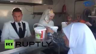Turkey: Bride and groom share their wedding feast with Syrian refugees