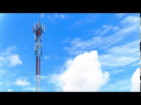 4K Time Lapse : Telecommunications antenna for telephone white cloud and Blue sky 2