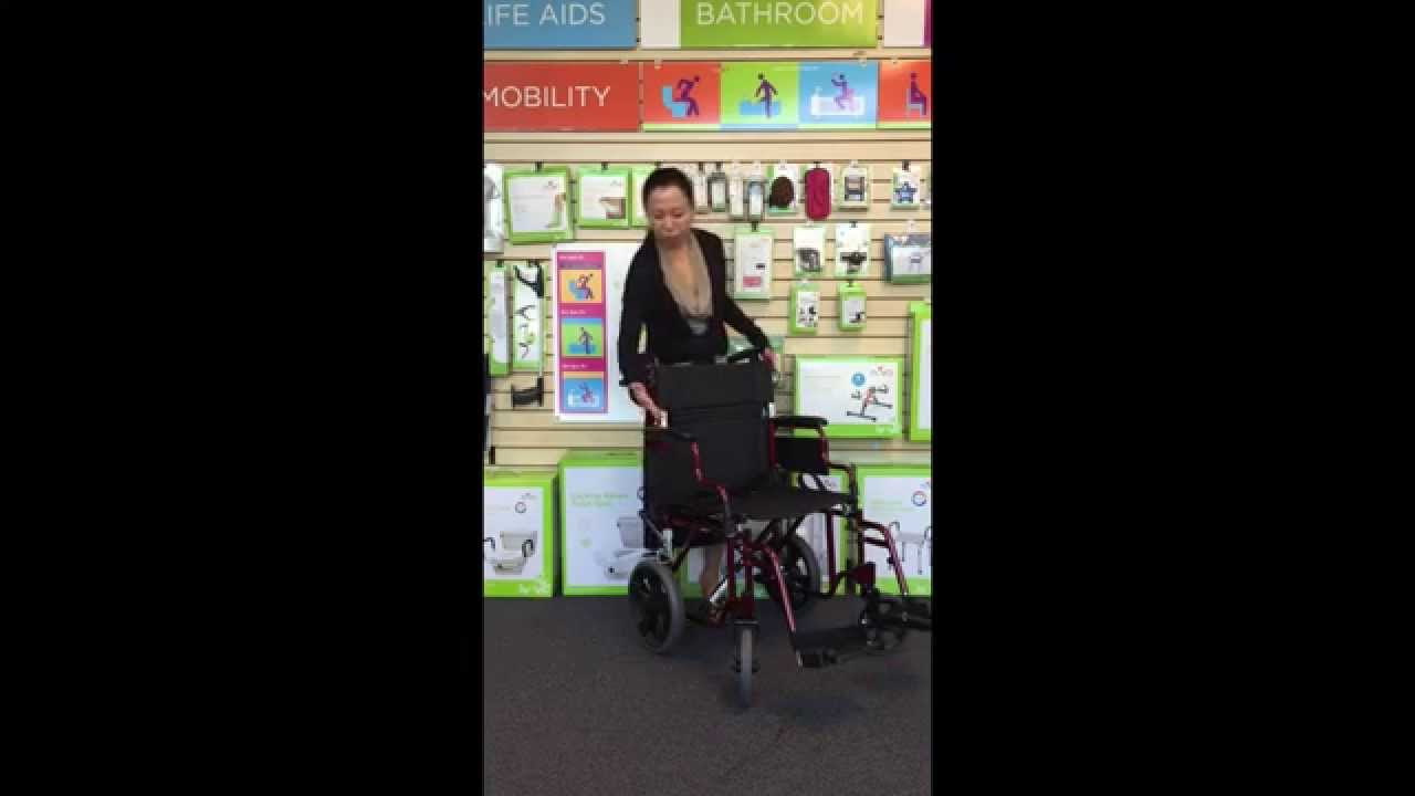 transport wheelchair nova leather armchairs uk chair with hand brakes and flip up desk arms youtube