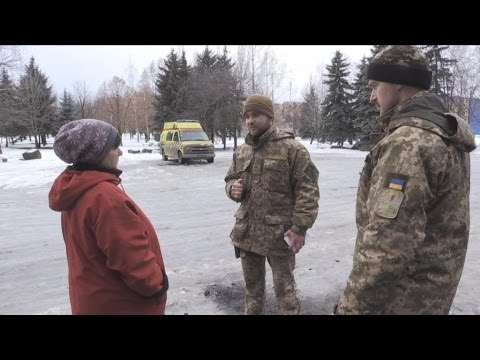 Ukraine: In newly retaken town, troops try to win local support