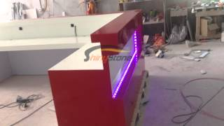 Red Glossy Solid Surface Reception Desk With Rgb Led Lighting