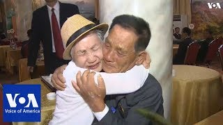 Families from North and South Korea reunite after decades apart