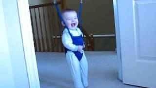 funny baby laughing in jolly jumper