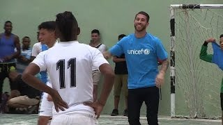 Real Madrid's Sergio Ramos plays football with Cuban children