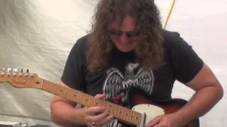 Wayne Alexander plays instrumental Guitar at Eumundi Markets Queensland Australia