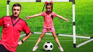 Mania and Daddy play with football