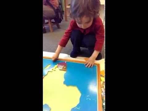 Lev works on puzzle of Africa at Little Flowers Montessori - 4/8/2014