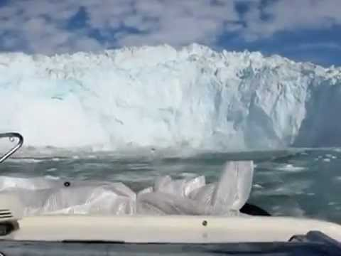 A giant glacier piece breaks off and causes a massive wave