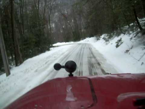 Snow Plowing down a hill in the Big Rig