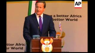 British PM Cameron on visit, comments on hacking scandal, Libya, Africa aid