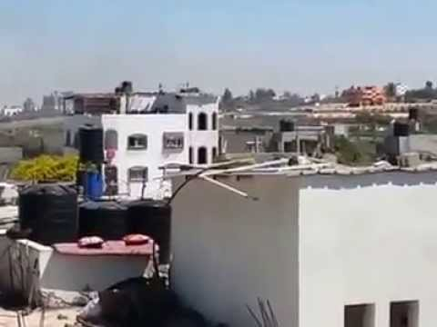 israel-mortar-hitting-roof-of-gaza-building-to-warn-of-imminent-israeli-strike