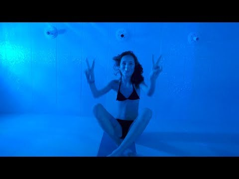 Carla swimming underwater at a Spa
