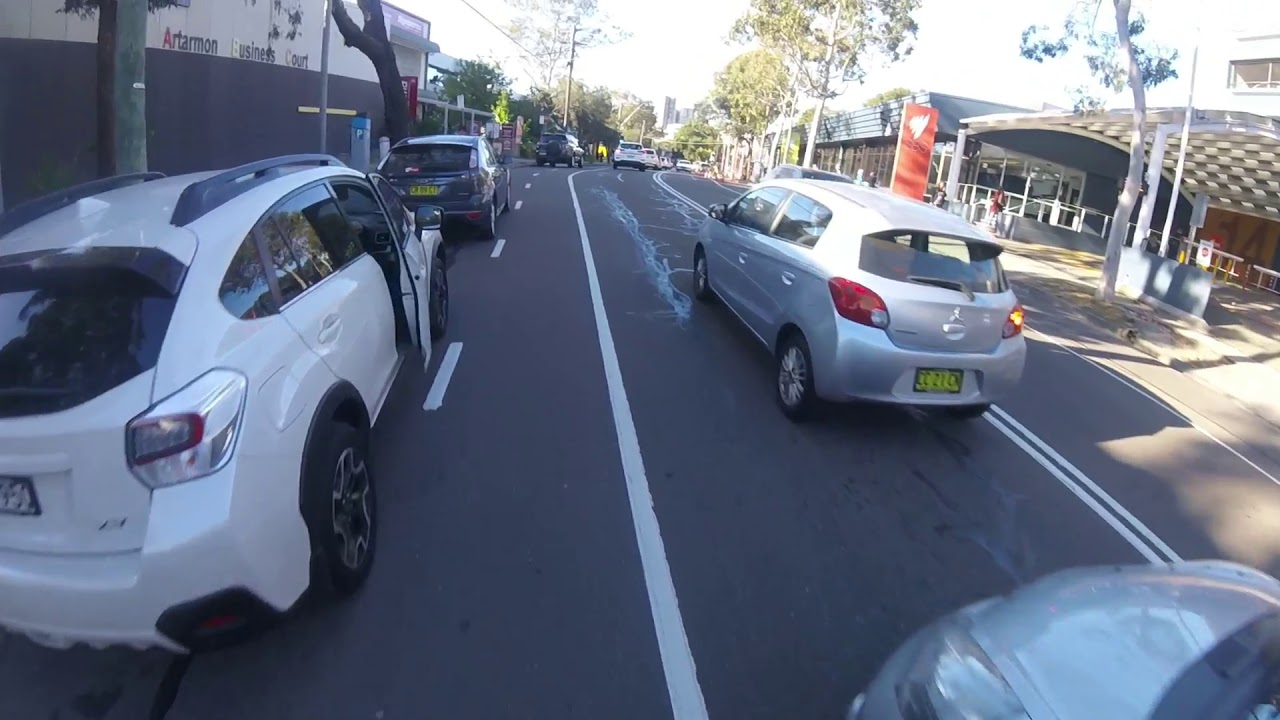 CLOSE CALL - Cyclist almost hit by car door