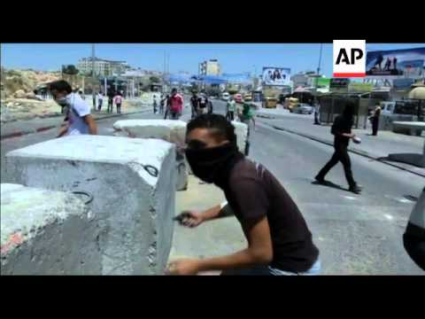 Palestinians clash with Israeli troops at checkpoint on Nakba Day