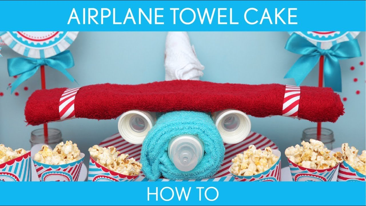 How to make airplane towel cake baby shower for Airplane baby shower decoration ideas