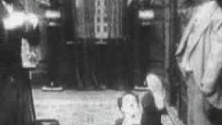 "Charlie Chaplin as the ""little tramp"""