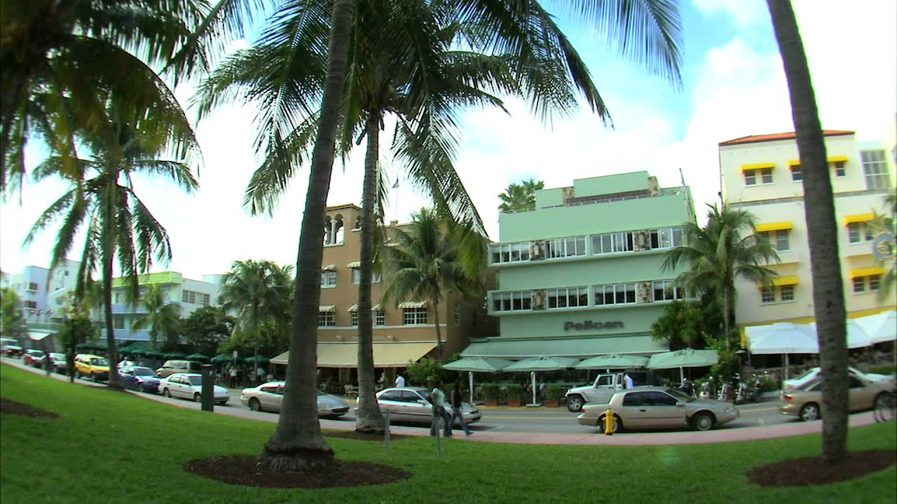 Colorful buildings and palm trees lining a Miami street. - YouTube