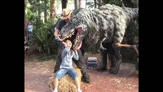 T-rex dinosaur bites girl