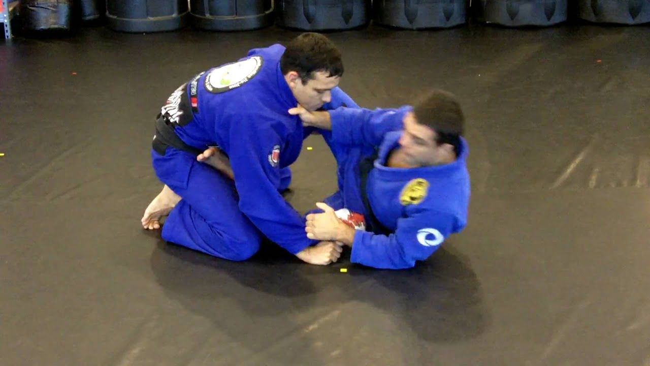 Robson Moura and Gustavo Dantas Show a Loop Choke from Open Guard