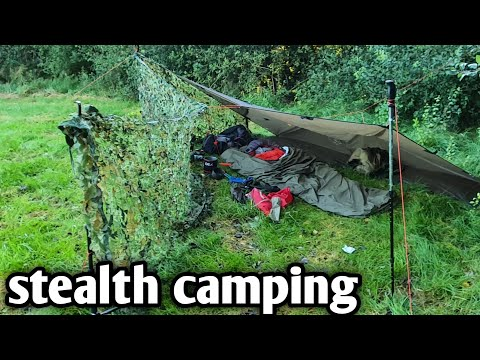stealth camping, wild camping using oex bivvi bag and oex tarp with  camouflage net