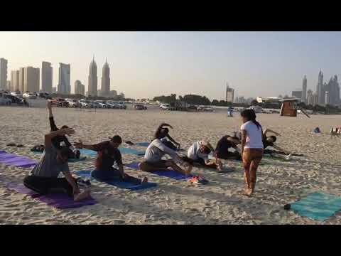 Yoga on the beach by Nidhi Yogini