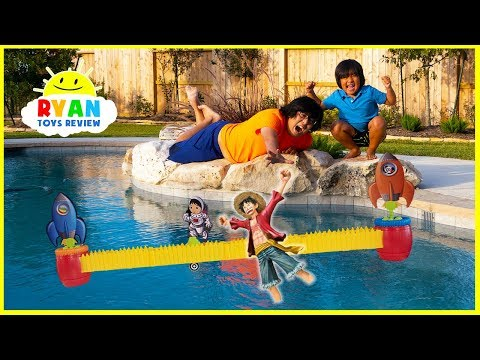 Ryans Rocket Race Game with Loser favorite toy into swimming pool!!!!